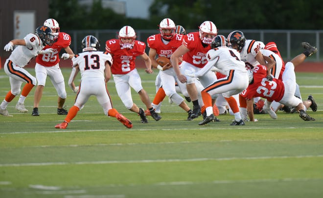 The Canton Chiefs run the ball against the Northville Mustangs on Sept. 18, 2020.