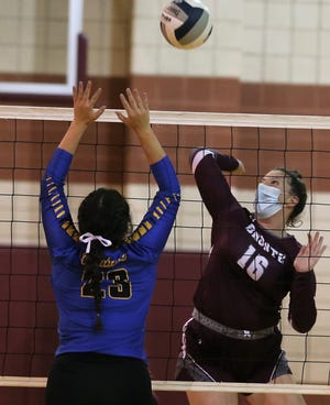 Bronte's Keeley Queen, right, goes up for an attack as Veribest's Meredith Robles defends the net during a District 7-2A volleyball match at the Bronte gym Saturday, Sept. 19, 2020.