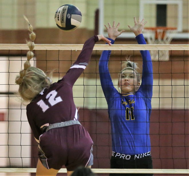 Veribest's Cora Blackwell blocks a kill attempt by Bronte's Katelyn Powell during a District 7-2A volleyball match at the Bronte gym Saturday, Sept. 19, 2020. Veribest won in four sets.