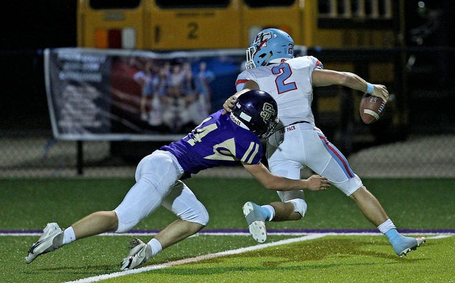 Will Sisco, left, makes a tackle for Sterling City during a game against Borden County on Friday, Sept. 18, 2020.