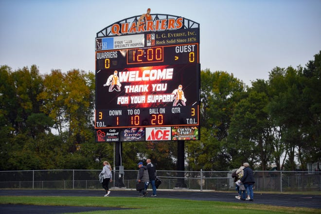 A new scoreboard is lit up as spectators file into the stands for a football game on Friday, September 18, at Dell Rapids High School.