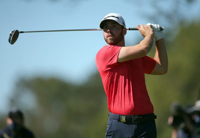 Westlake High graduate Matthew Wolff watches his tee shot from the ninth tee during the third round of the U.S. Open at Winged Foot Golf Club in New York on Saturday. Wolff shot a 65 and leads by two shots heading into Sunday's final round.
