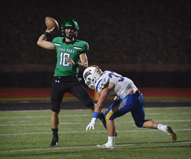 Iowa Park quarterback Cirby Coheley throws over Brock linebacker Dillon Mueller (33) Friday night.