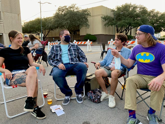 Former Trivia Master at Wichita Falls Brewing Company, Marcos Lopez (second from the left), a mathematics professor at Midwestern State University, may no longer have time to host Trivia but he still plays now that is has resurfaced outside at the WFBC and moved to 7 p.m. Thursday