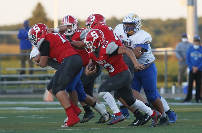 Sheridan's Jason Munyan carries the ball against Philo in last week's win. He had 169 yards against the Electrics, and opposing defenses have had trouble corralling the Generals' running back.