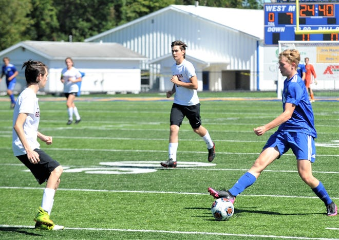 West Muskingum's Landon Walter controls the ball against a Caldwell defender in Saturday's 9-0 win at Whirlwind Stadium.
