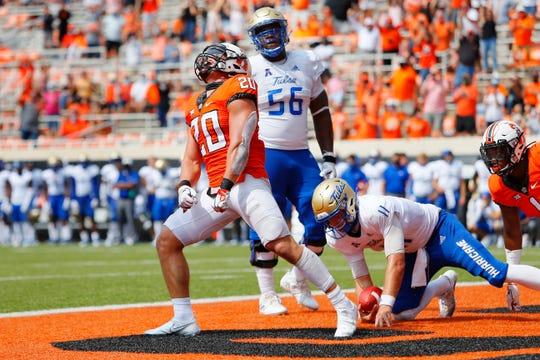 Oklahoma State linebacker Malcolm Rodriguez celebrates after sacking Tulsa quarterback Zach Smith during the fourth quarter at Boone Pickens Stadium.