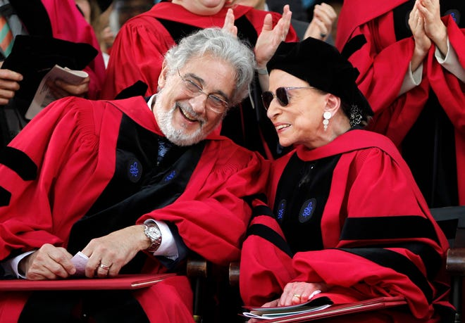 Supreme Court Justice Ruth Bader Ginsburg chats with opera tenor Placido Domingo at Harvard University's 360th commencement exercises, in Cambridge, Massachusetts, in 2011.