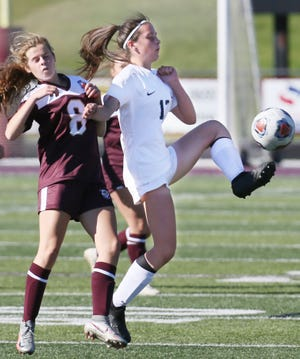 Hoban's Lauren Mahoney kicks the ball as Stow's Corinne Casenhiser defends in a game in September.