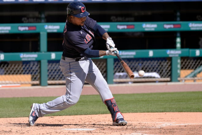 Cleveland Indians' Jose Ramirez bats against the Detroit Tigers in the fourth inning of a baseball game, Sunday, Sept. 20, 2020, in Detroit. (AP Photo/Jose Juarez)