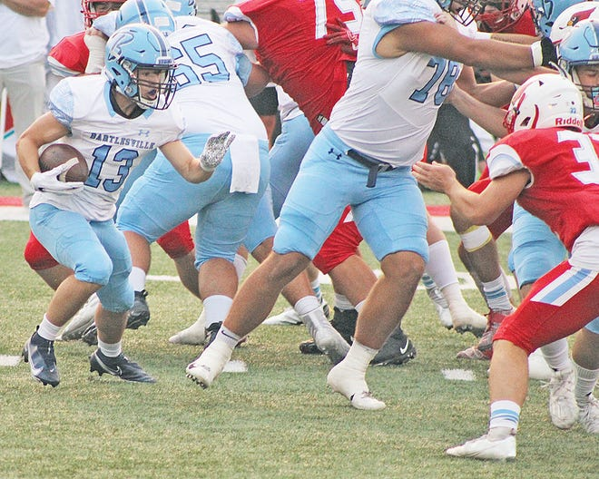 Bartlesville High's Dylan McCoy, No. 13, picks his way through a hole during last Friday's football clash at Collinsville.