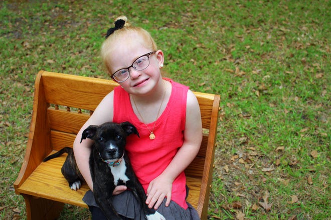 "Paisley Metz, 7, of Rincon, knows the right question to ask when meeting new people. If she were to see you at a store, she'd walk up to you and ask, ""What's your dog's name?"" even if no dog is present. She is shown with her dog, whose name is Sadie."