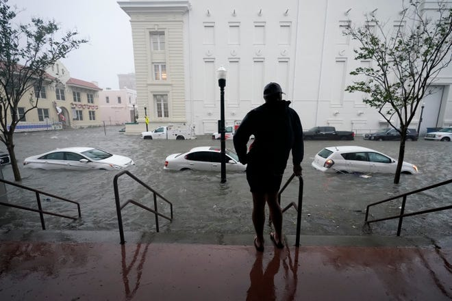 Floodwaters move on the street Wednesday in Pensacola, Fla.  The Census Bureau is contending with several natural disasters as wildfires and hurricanes disrupt the final weeks of the nation's once-a-decade headcount.