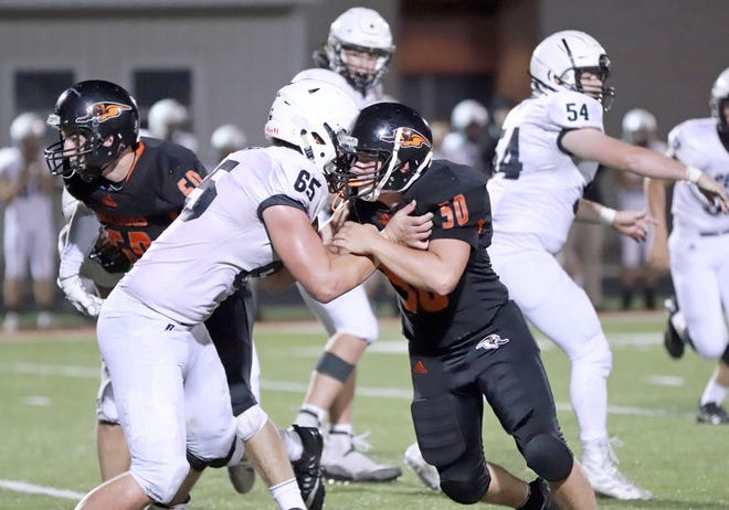 Mediapolis junior Ryan Konecne (50) helped Bulldogs' offensive line open holes for the team to rush for 243 yards in a 20-3 win over Pekin Saturday at Mediapolis.