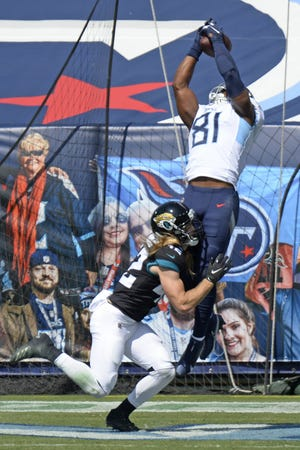 Tennessee Titans tight end Jonnu Smith catches a touchdown pass over Jaguars safety Andrew Wingard in the first half of their game in Nashville on Sept. 20. The Titans led 14-0 at one point before winning 33-30. Every Jaguars opponent this season has scored a touchdown on their first possession.