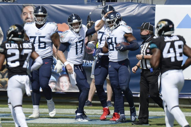 Jonnu Smith, who played for the Titans last season, is one of the top available free agent tight ends who could be targeted by the Jaguars. AP Photo/Mark Zaleski