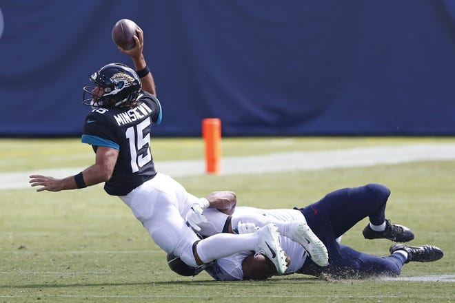 Jaguars quarterback Gardner Minshew (15) is sacked by Titans defensive tackle Jack Crawford for a 20-yard loss Sunday.