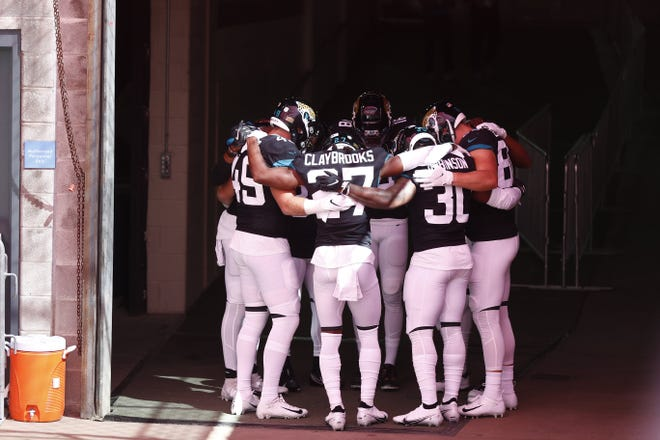 Jaguars players huddle together before entering the field Sunday against the Titans.