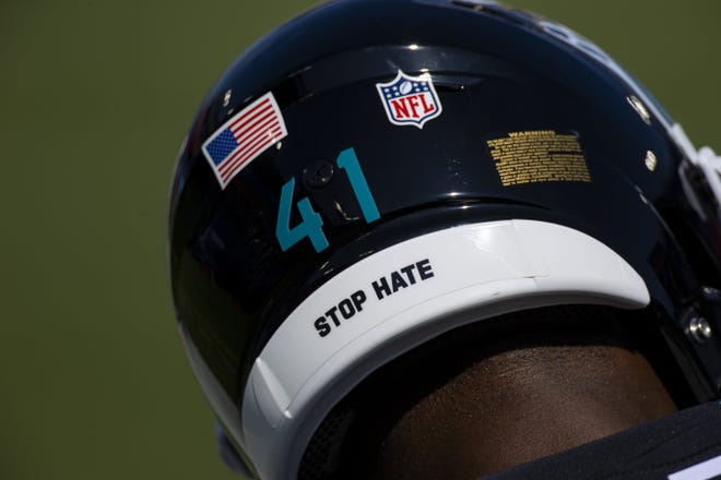 "Jaguars pass rusher Josh Allen wears a ""Stop Hate"" sticker on his helmet before Sunday's game in Tennessee."