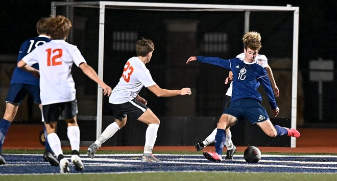 Hudson senior Quinn Groves takes a shot on goal during the Explorers' 5-1 home win over North Canton Hoover Sept. 19. Groves scored three goals in the win.