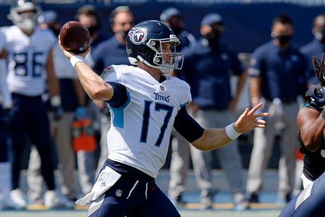 Tennessee Titans quarterback Ryan Tannehill (17) passes against the Jacksonville Jaguars in the first half Sunday in Nashville, Tenn.