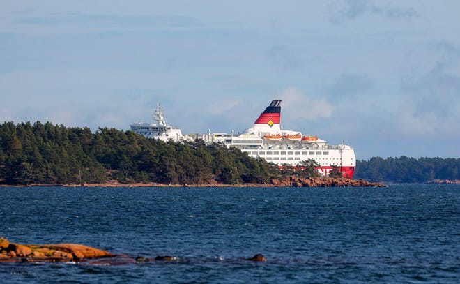 Viking Line's cruise ship M/S Amorella is seen near the Aland islands, seen from Finland, on Sunday. Finnish authorities said the Baltic Sea passenger ferry with nearly 300 people ran aground in the Aland Islands archipelago between Finland and Sweden without injuries.