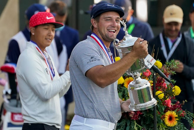 Bryson DeChambeau, of the United States, holds up the trophy after winning US Open Golf Championship on Sunday in Mamaroneck, N.Y.