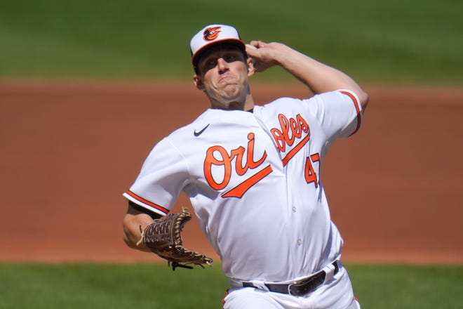 Baltimore Orioles starting pitcher John Means throws a pitch to the Tampa Bay Rays during the second inning  Sunday in Baltimore.