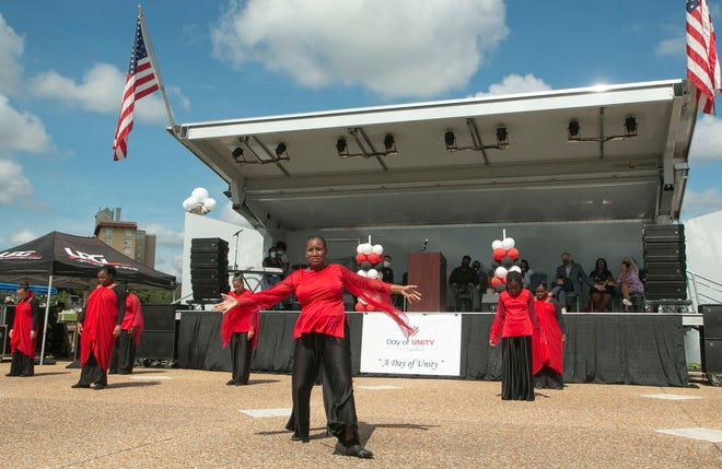 The Faith Celebration Church Dance Ministry performs during the Day of Unity event at the Lake Mirror Amphitheater in Lakeland on Saturday.