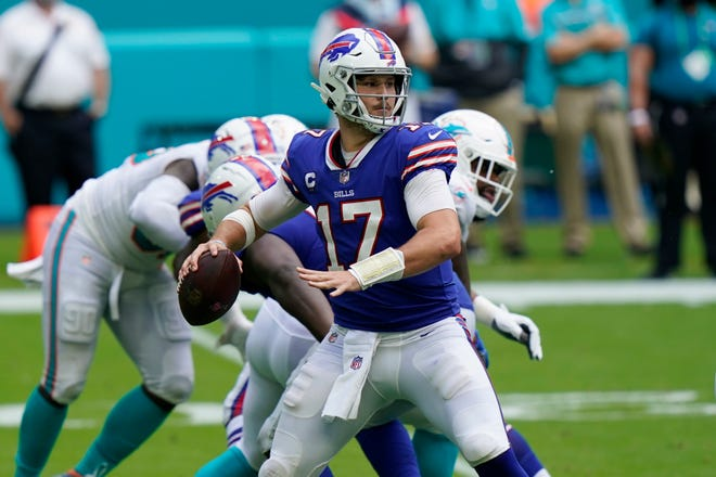 Buffalo Bills quarterback Josh Allen (17) looks to pass  during the second half Sunday against the Miami Dolphins in Miami Gardens.