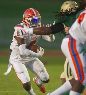 Bartow's Amarion Baker rushes the ball against George Jenkins earlier this year. The Yellow Jackets are undefeated heading into Friday's matchup against Winter Haven. A win would give Bartow, now 6-0, the most wins the program has had since 2006, when it 10 games..