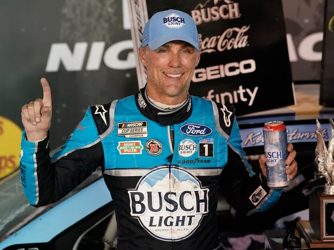 Kevin Harvick celebrates in Victory Lane after winning the NASCAR Cup Series auto race Saturday in Bristol, Tenn.