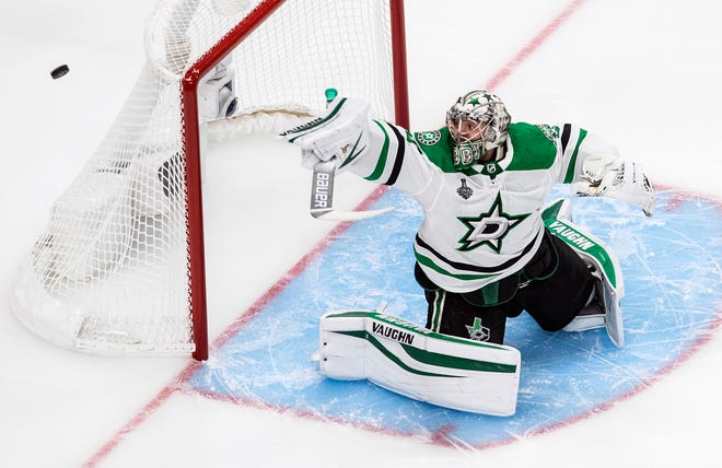 Dallas Stars goaltender Anton Khudobin (35) makes a save against the Tampa Bay Lightning during first-period NHL Stanley Cup finals action in Edmonton, Alberta, on Saturday.