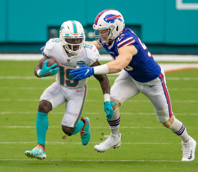Dolphins receiver Jakeem Grant is pursued by Bills linebacker Tyrel Dodson.