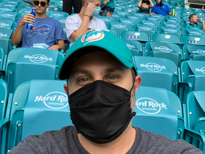 Former Palm Beach Post sports writer Andrew Abramson has attended many games at Hard Rock Stadium through the years, but he never wore a mask until Sunday.