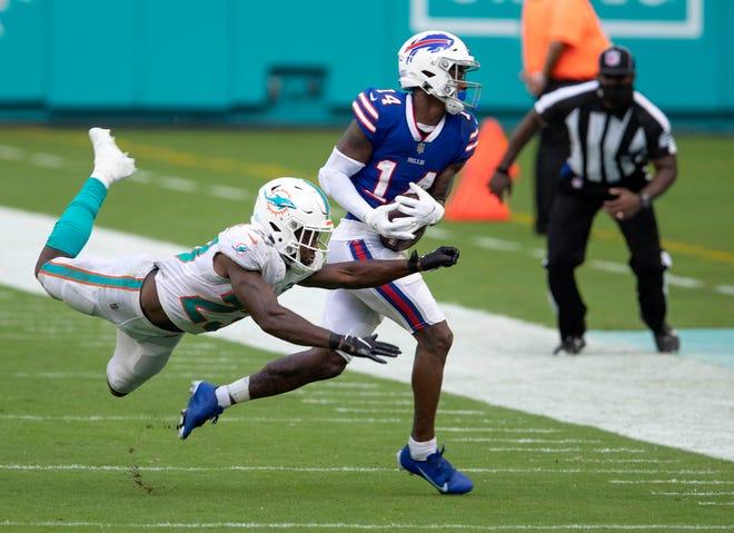 Miami Dolphins cornerback Noah Igbinoghene, left, defends Buffalo Bills wide receiver Stefon Diggs at Hard Rock Stadium.