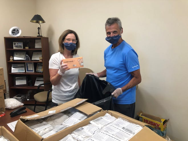 Jerry and Lisa Kilian pack personal protective equipment on behalf of the United Way of Palm Beach County. The organization has teamed with the Community Foundation for Palm Beach and Martin Counties and Children's Services Council to distribute $100,000 in PPE to 122 local charitable organizations.