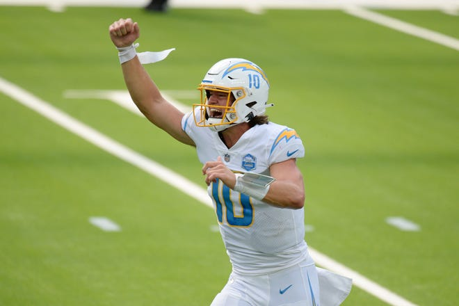 Former Oregon Ducks quarterback Justin Herbert celebrates after throwing his first career touchdown pass for the Los Angeles Chargers against the Kansas City Chiefs on Sunday in Inglewood, Calif. [AP Photo/Kyusung Gong]