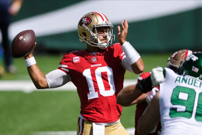 San Francisco 49ers quarterback Jimmy Garoppolo throws a pass during the first half against the New York Jets on Sunday in East Rutherford, N.J. [AP Photo/Bill Kostroun]