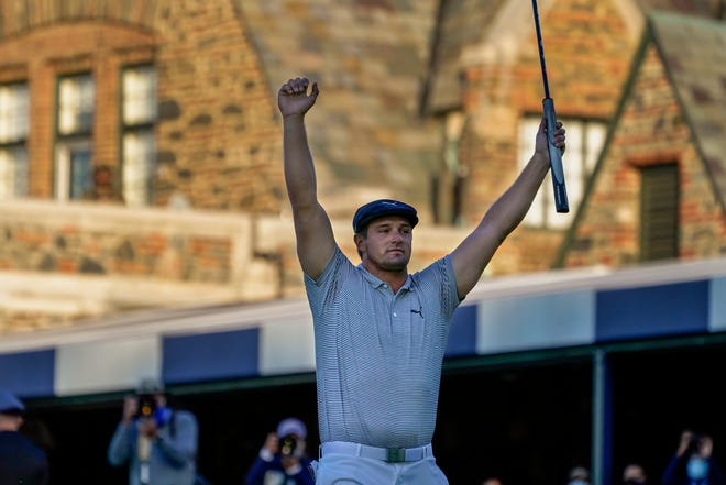 Bryson DeChambeau reacts after sinking a putt for par on the 18th hole to win the US Open Golf Championship at Winged Foot for his first major title on Sunday in Mamaroneck, N.Y.