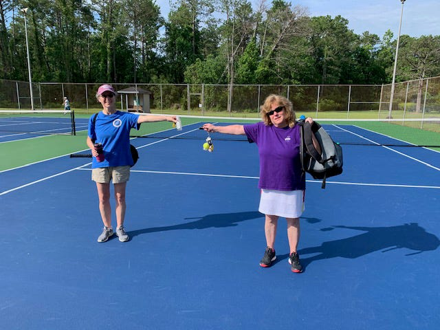 Beth Cooper and Sarah Schwartz show that you can social distance even if you play doubles. Everyone comes to the tennis courts with their own water bottles, hand sanitizers, and gear as recommended by the experts. [CONTRIBUTED PHOTO]
