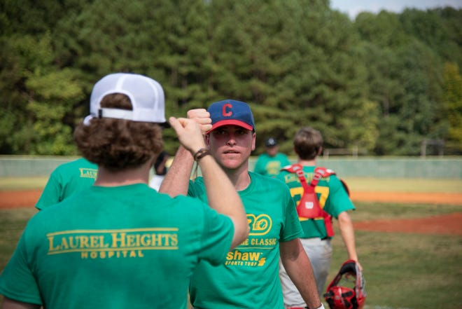 Players pound fists after an Alternative Baseball game. The organization is for players 15-and-older with special needs.