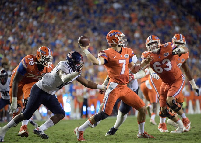 Florida quarterback Will Grier throws a pass in front of Mississippi linebacker C.J. Johnson (10) during the Oct. 3, 2015 game at Ben Hill Griffin Stadium.