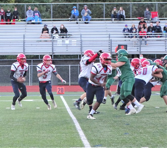 Fairfield Christian Academy quarterback Zi'Year Pardon gets set to take off on a run with Samuel Rauch and Luke Herron leading the way against Fisher Catholic Saturday night at Fulton Field. The Irish won 14-6.