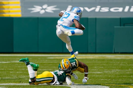D'Andre Swift (D'Andre Swift) of the Detroit Lions surpassed Adrian of the Green Bay Packers in the second half of the NFL football game held in Green Bay, Wisconsin, USA on Sunday, September 20, 2020. Amos and Raven Green (AP Photo / Morry Gash)