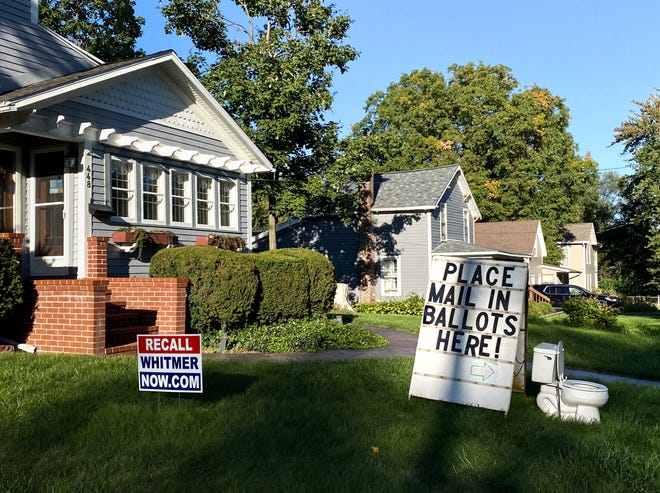 A political display is set up in the lawn of a home in Mason, Mich., seen Friday, Sept. 18, 2020.