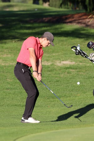 Port Clinton's Noah Shaw chips onto the green.