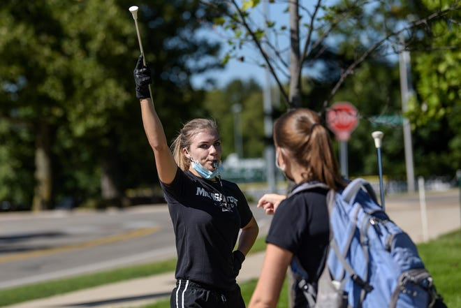Drum major Lisa Lachowski, right, helps second drum major Samantha Barringer practice the drum major's routine while practicing the Spartan Marching Band march into Spartan Stadium on Friday, Sept. 18, 2020, in East Lansing. The band will not be performing for football games this year due to the COVID-19 pandemic.