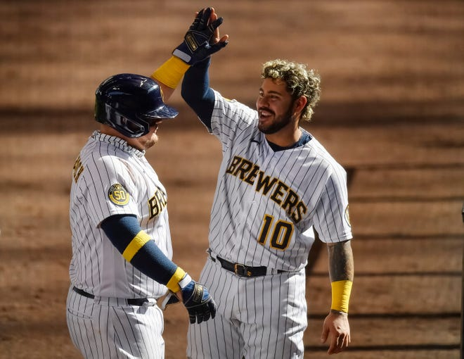 Omar Narvaez (right) congratulates Daniel Vogelbach for his three-run home run in the sixth inning against the Kansas City Royals at Miller Park on September 20, 2020 in Milwaukee, Wisconsin.