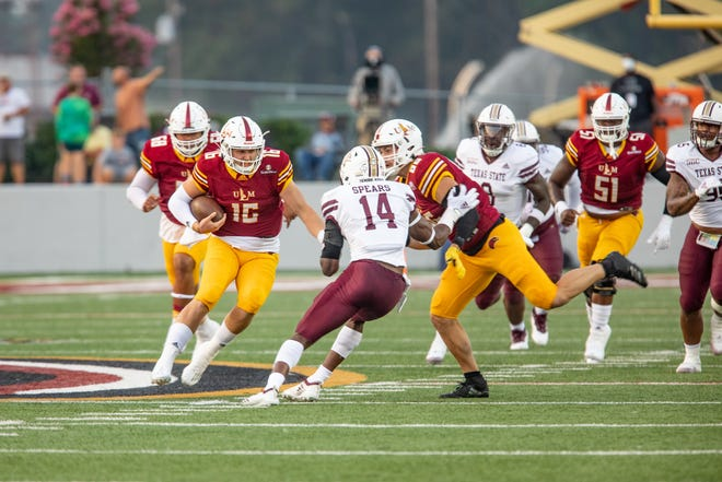 ULM quarterback Colby Suits scrambles upfield in Saturday's 38-17 loss to Texas State at Malone Stadium.